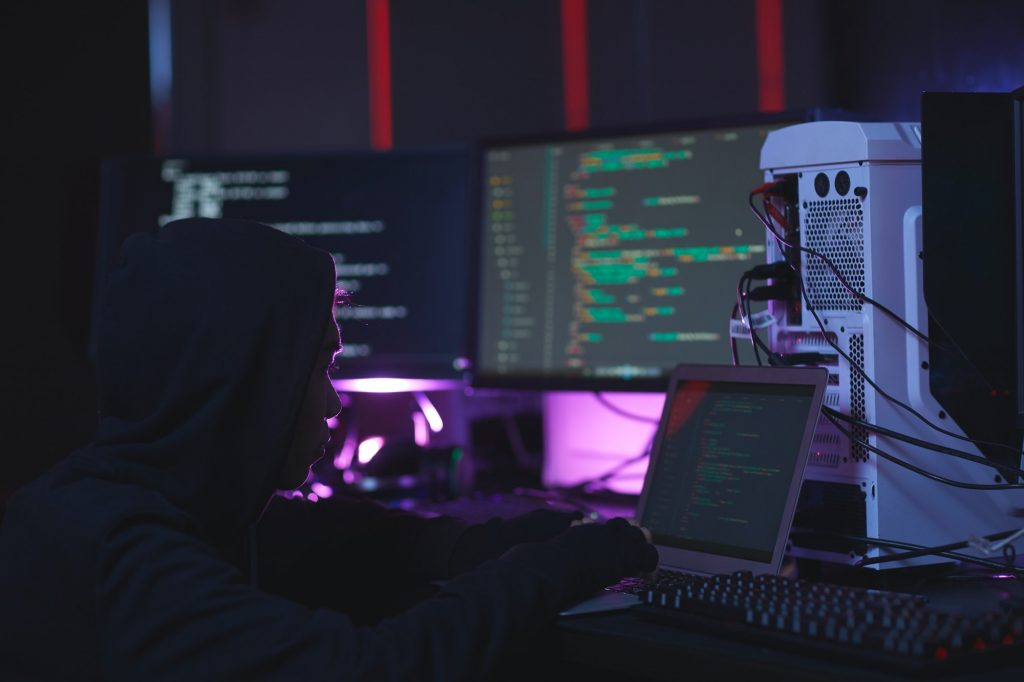 Unrecognizable Hacker in Dark